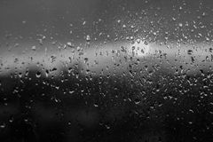 Unfocuced sun. And water drops on the window black and white Royalty Free Stock Photography