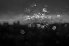 Unfocuced sun. And water drops on the window black and white Royalty Free Stock Photo