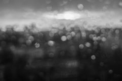 Unfocuced sun. And water drops on the window black and white Royalty Free Stock Image