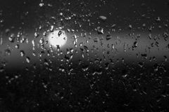 Unfocuced sun. And water drops on the window black and white Stock Images