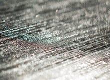 Unfocused achtergrond van het zilver schitteren van waterdruppeltjes op de zwarte royalty-vrije stock foto