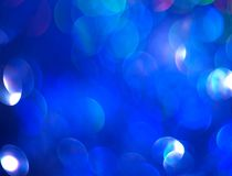The unfocused blue background of abstract brilliance. For text, banner, poster, label, sticker, wallpaper, layout royalty free stock photography