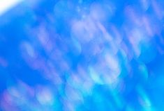 The unfocused blue background of pearly glare. royalty free stock photos