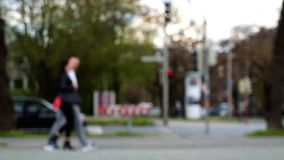 Unfocused Blurred Intersection People Cars Bicycles. Unfocused blurred intersection with pedestrian walkway. People walking, bicyclists and inline skaters stock video footage