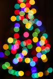 Unfocused Christmas tree with colorful lights Royalty Free Stock Image