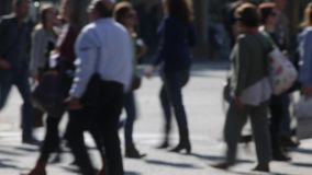 Unfocused pedestrians.(01). Unfocused pedestrians crossing a street in the city of Barcelona stock video