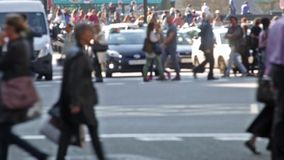 Unfocused pedestrians.(06). Unfocused pedestrians crossing a street in the city of Barcelona stock video footage