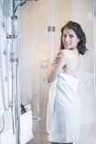 Unfocused portrait of a woman showering through the bath screen with little drops.Relief and relaxation after long stressful day. Stock Photo