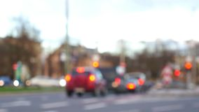 Unfocused Scene of Blurred Cars on Intersection. With Red Traffic Lights and Break Lights stock video