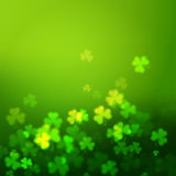 Unfocused shamrock leaves, Saint Patricks Day vector background Stock Photos