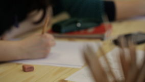 Unfocused view of male student drawing picture. stock video footage