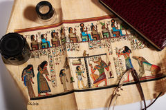 Unfolded ancient Egyptian scroll. On a white background Stock Image