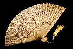 Unfolded ancient fan isolated on black. Ancient fan unfolded on black background Stock Photography
