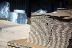 Unfolded cardboards for boxes in the warehouse. Photo of unfolded cardboards for boxes in the warehouse stock photo