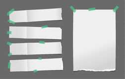 Unfolded ripped white card, note paper or blank brochure, leaflet with shadow stuck with green sticky tape on dark. Background Royalty Free Stock Photos