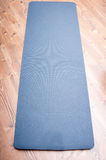 Unfolded yoga mat Stock Photo