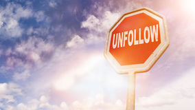Unfollow, text on red traffic sign Royalty Free Stock Photo