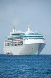 Unforgettable cruise vacation. Modern cruise ship at exotic Caribbean port Stock Photos