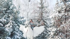 Unforgettable positive emotions, first ride horse, pretty lady in long gray cape with bare shoulders sits on white