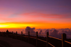 Unforgettable Sunset on Haleakala Volcano. A man is witnessing the unforgettable beauty of a sunset viewed from the top of the Haleakala Vocalno, Maui, Hawaii stock photo