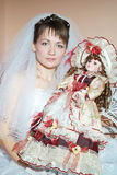 Unfortunate bride holding a beautiful doll Stock Photos