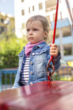 The unfortunate little girl on the playground Stock Photo