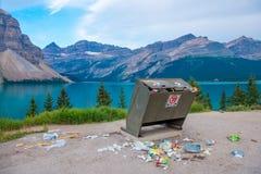 Unfortunate overflowing Bear proof trash receptacle Banff National Park Stock Image