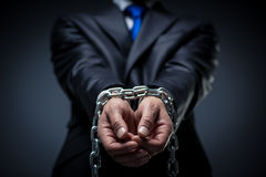 Unfreedom. Man in a suit with his hands tied Royalty Free Stock Photos