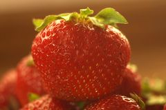 Unfresh strawberry. Macro photo of a single unfresh strawberry stock photo