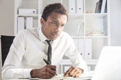 Unfriendly man working on project Stock Image