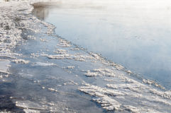 Unfrozen in winter the river. The ice edge on unfrozen river in winter Royalty Free Stock Images