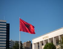 Unfurled Albanian Flag with National Theatre of Opera and Ballet of Albania