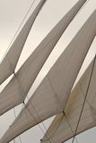 Unfurled jibs on a wooden sailing bark. The four jib sails unfurled on a wooden bark, an old sailing ship Stock Image