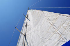 Unfurled mainsail blue sky. Royalty Free Stock Photos