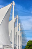 Unfurled Sails. Rows of stretched materials making up a building roof appear as unfurled sails Stock Images