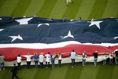 Unfurling of gigantic American Flag Stock Photo