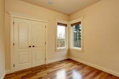 Unfurnished room with hardwood floor. Stock Photography