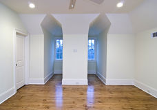 Unfurnished upstairs bedroom. With gable openings Stock Image