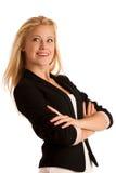 Ung affärskvinna med blont hår och blåa ögon som gör en gest su royaltyfri foto