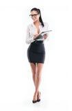Ung affärskvinna med formen och blyertspennan Royaltyfria Foton