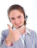 Ung affärskvinna med hörlurar med mikrofon Royaltyfria Foton