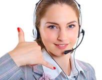 Ung affärskvinna med hörlurar med mikrofon Arkivfoto