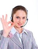 Ung affärskvinna med hörlurar med mikrofon Arkivbilder