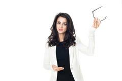 Ung affärskvinna på vit bakgrund royaltyfri foto