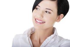 Ung affärskvinna som ser till sidan Arkivbild