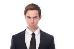 Ung affärsman med allvarligt uttryck på hans framsida fotografering för bildbyråer