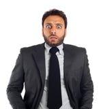 Ung affärsman med ett uttryck av skräck fotografering för bildbyråer
