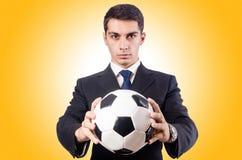 Ung affärsman med fotboll Arkivfoto