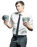 Ung affärsman med pengar Arkivbilder