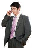 Ung affärsman med telefonen Arkivbild